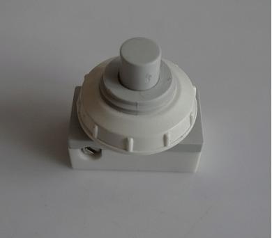 Vestavný spínač jednopólový kruhový - tlačítko